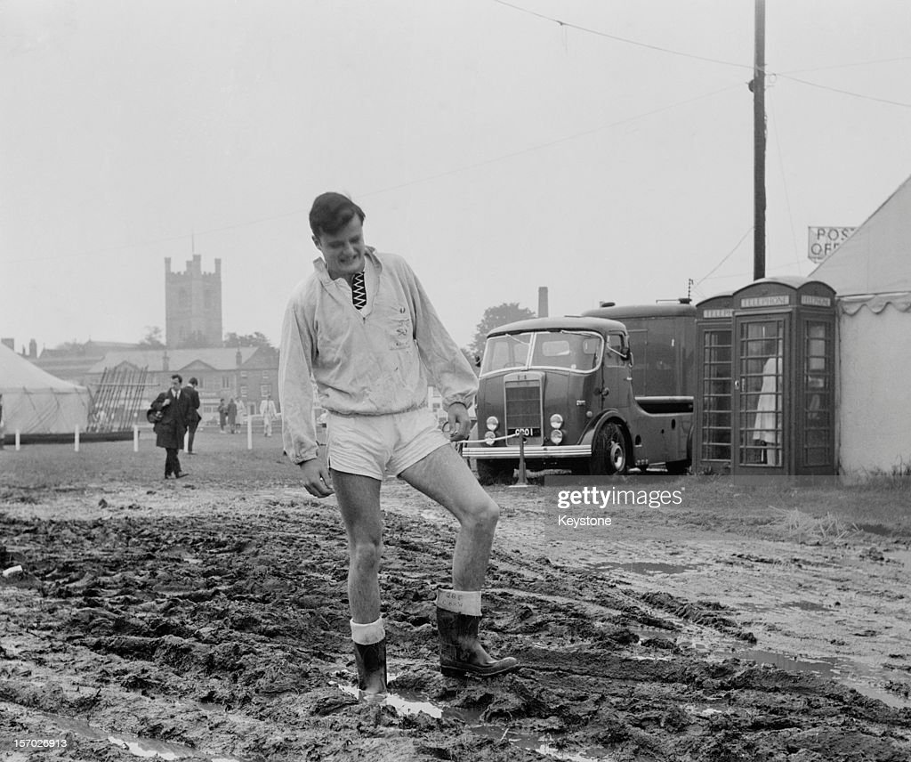 Rower J R Smith of St Paul's School negotiating the unseasonal mud at Henley Royal Regatta HenleyonThames Oxfordshire 3rd July 1963