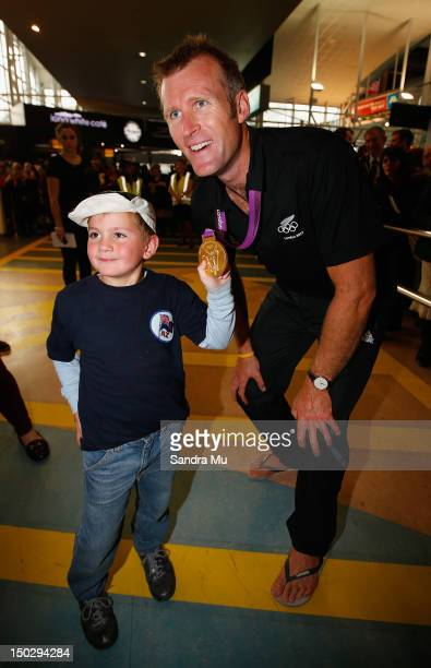 Rower Mahe Drysdale of the New Zealand Olympic team poses with a young fan at Auckland International Airport after competing in the 2012 London...