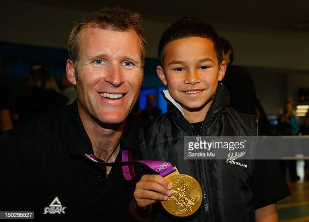 Rower Mahe Drysdale of the New Zealand Olympic team poses with Nico Mu and his gold medal at Auckland International Airport after competing in the...