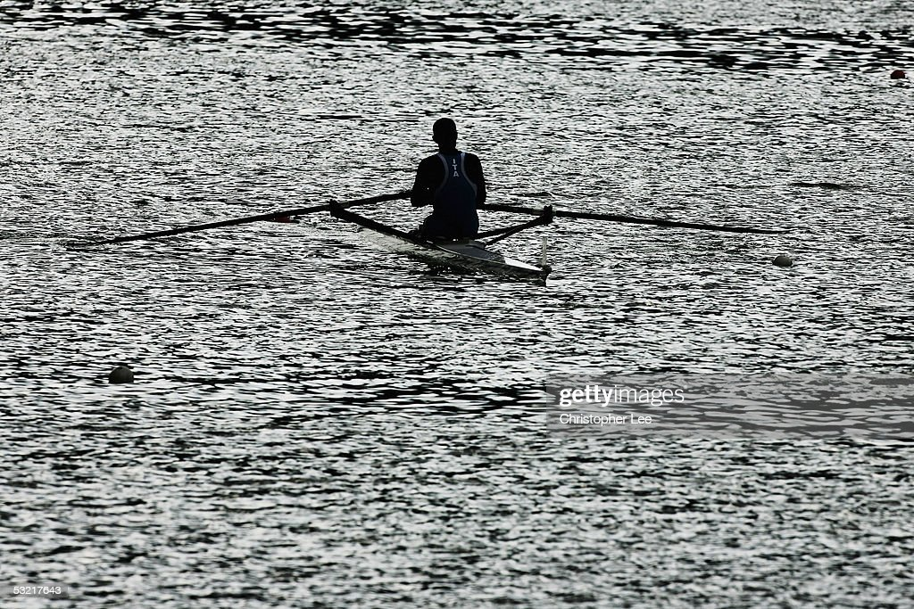 A rower sits in a boat during the Bearing Point Rowing World Cup Day 2 on the Rotsee on July 9, 2005 in Lucerne, Switzerland.