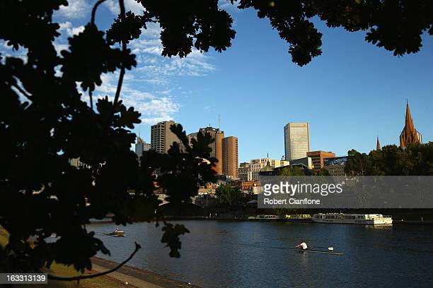 Rowers are seen on the water during an afternoon training session on the Yarra River March 6 2013 in Melbourne Australia Rowing has been held on the...