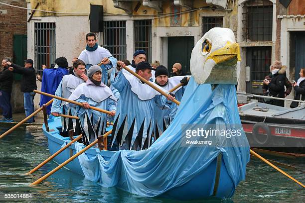 Rowers dressed in costumes take part in the traditional regatta along rio Canareggio which officially opens the Venice Carnival