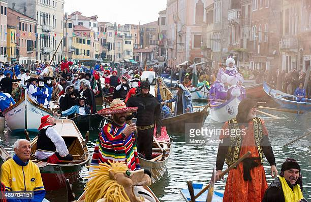 Rowers dressed in costumes take part in the traditional regatta pn the Grand Canal which officially opens the Venice Carnival on February 16 2014 in...