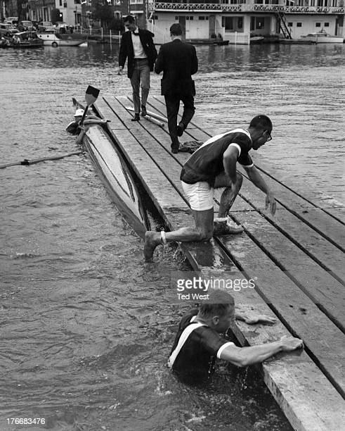 Rowers from Cornell University swim to a landing stage after their boat capsized following their win in the Wyfold Fours event at Henley Royal...