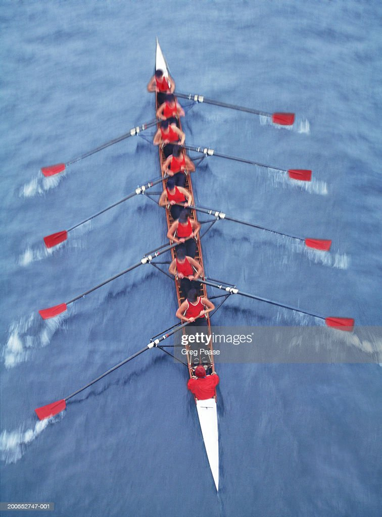 Rowers in eight person-scull, elevated view (blurred motion) : Stock Photo