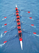 Rowers in eight person-scull, elevated view (blurred motion)