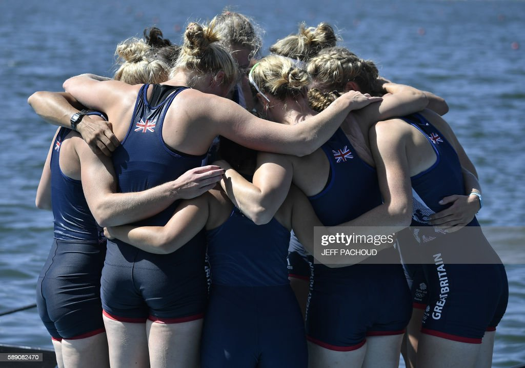 CORRECTION Rowers of Britain's team celebrate after being second the Women's Eight final rowing competition at the Lagoa stadium during the Rio 2016...