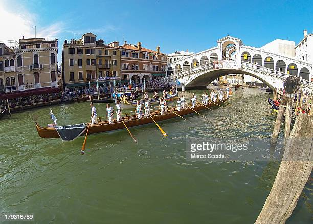 Rowers sail under the Rialto Bridge during the Historic Regata 2013 on the Grand Canal on September 1 2013 in Venice Italy The Historic Regata is the...