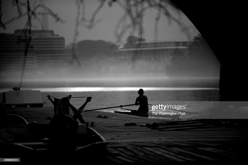 Rowers take off at the Key Bridge while fog covers the Potomac River in Washington DC November 12 2014