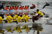 Rowers take part in a dragon boat race on the Narathiwat river in Thailand's southern province on September 25 2012 The annual fiveday boat rowing...