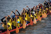 Rowers take part in a dragon boat race on the Narathiwat river in Thailand's southern province of Narathiwat on September 19 2015 The annual fiveday...