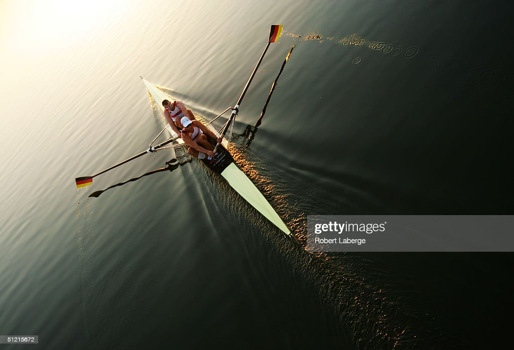 Rowers train in early morning sunlight on August 21, 2004 during the Athens 2004 Summer Olympic Games at the Schinias Olympic Rowing and Canoeing Centre in Athens, Greece.