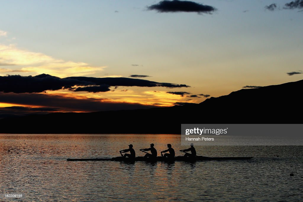 Rowers warm up during day three of the New Zealand Rowing Championships at Lake Ruataniwha on February 21, 2013 in Wellington, New Zealand.