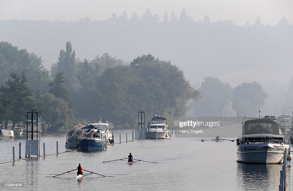Rowers warm up prior to the start of racing on finals day of the Henley Royal Regatta on July 7, 2013 in Henley-on-Thames, England.