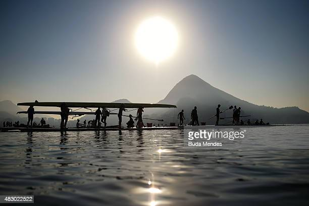 Rowing athletes carry their boat ahead a training session at the World Rowing Junior Championships at Lagoa Rodrigo de Freitas on August 5 2015 in...