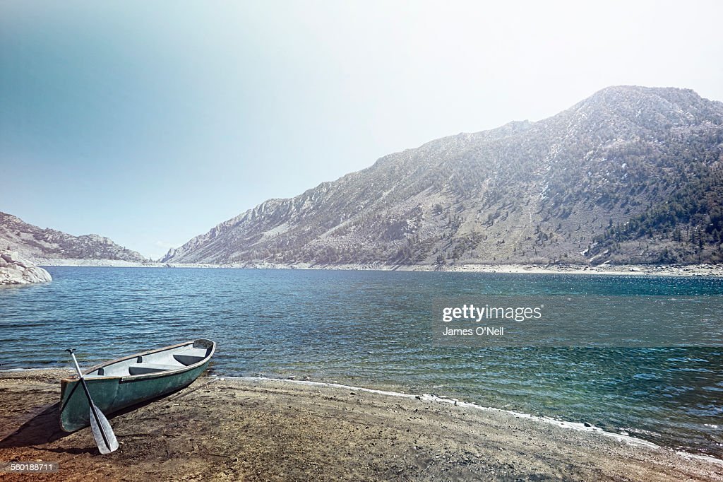 Rowing Boat mored up on beach shore