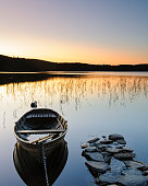 Rowing boat on calm water