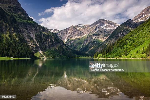 Rowing boat on mountain lake