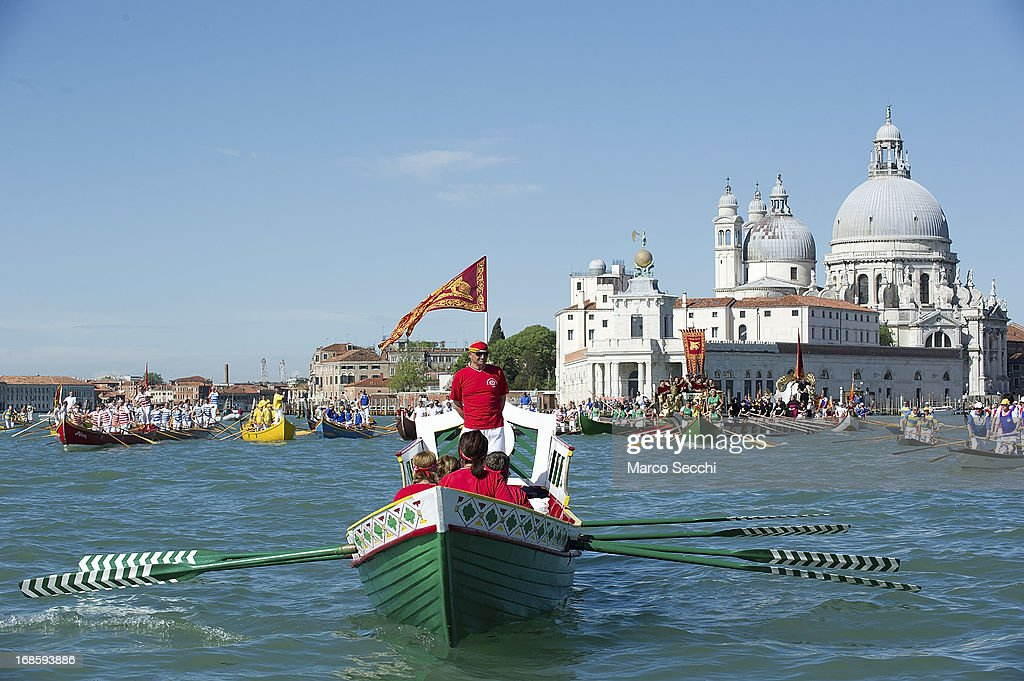 A rowing boat sails during the Sensa procession in Bacino Saint's Mark on May 12, 2013 in Venice, Italy. The festival of la Sensa is held in May on the Sunday after Ascension Day and follows a reenactment of the traditional ceremony where the Doge (Duke) enacted the wedding of Venice to the sea.