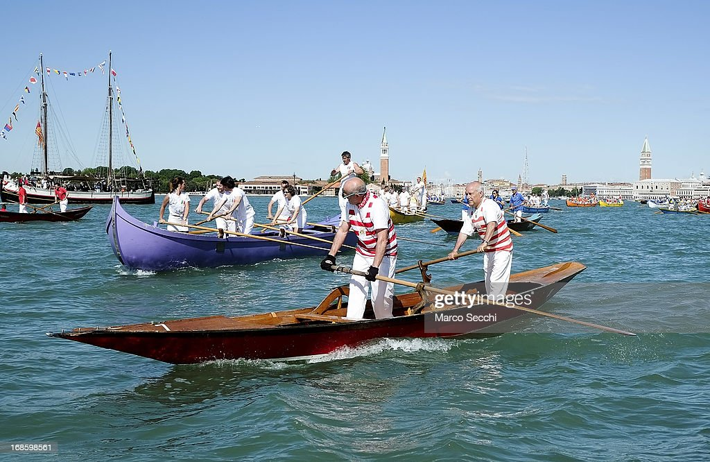 A rowing boat sails in front of La Salute during the Sensa procession on May 12, 2013 in Venice, Italy. The festival of la Sensa is held in May on the Sunday after Ascension Day and follows a reenactment of the traditional ceremony where the Doge (Duke) enacted the wedding of Venice to the sea.