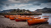 Rowing boats lying on beach at Derwentwater Keswick  in the Lake District, England