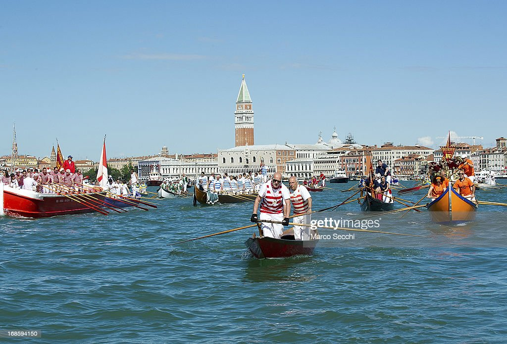 Rowing boats sail in front of the Doge Palace during the Sensa procession in Bacino Saint's Mark on May 12, 2013 in Venice, Italy. The festival of la Sensa is held in May on the Sunday after Ascension Day and follows a reenactment of the traditional ceremony where the Doge enacted the wedding of Venice to the sea.