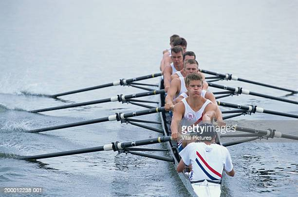 Rowing crew in boat, elevated view