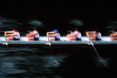 Rowing crew racing, elevated view (blurred motion)