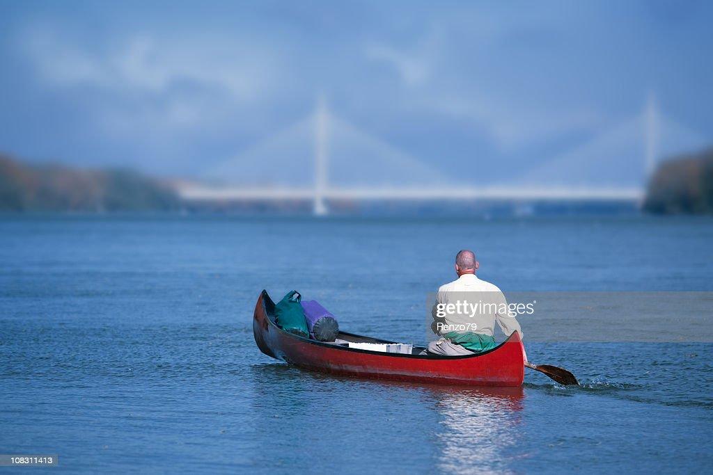 rowing towards the bridge : Stock Photo