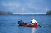 rowing towards the bridge