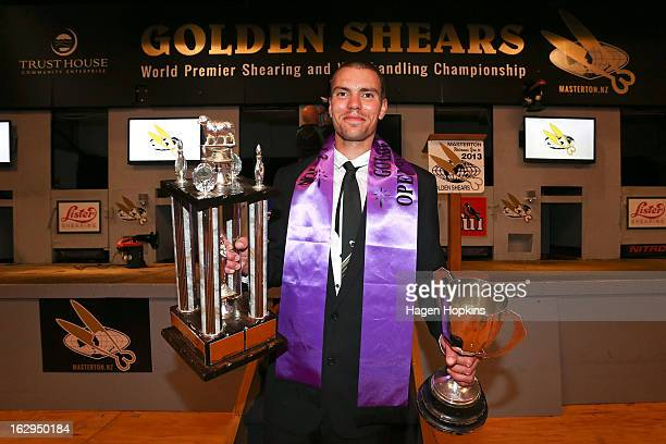 Rowland Smith poses with the Open Challenge Trophy and John Henson Memorial Trophy after winning Open Shearing Final during the Golden Shears...