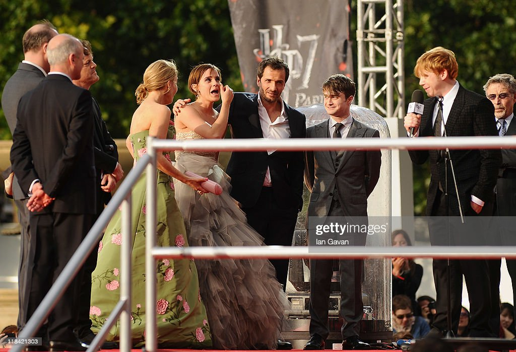 JK Rowling, Emma Watson, Jason Isaacs and Daniel Radcliffe look on as Rupert Grint speak to the fans on stage during the World Premiere of Harry Potter and The Deathly Hallows - Part 2 at Trafalgar Square on July 7, 2011 in London, England.