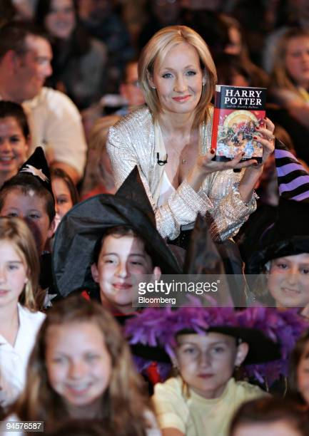 J K Rowling holds her new book 'Harry Potter and the Deathly Hallows' at a launch party in the Natural history Museum in London UK Friday July 20 2007