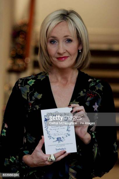 JK Rowling pictured with her book 'The Tales of Beedle the Bard' which is to be auctioned in Sotheby's on Thursday December 13 to raise funds for the...