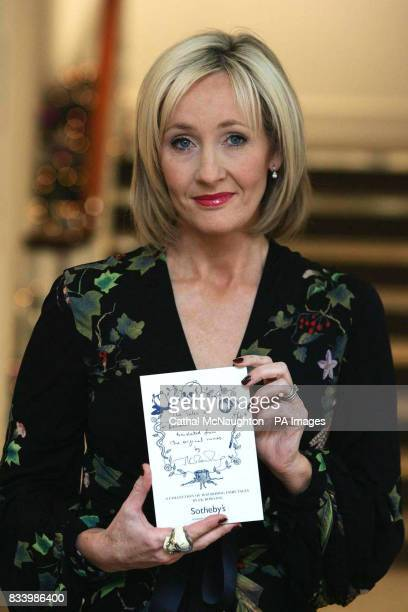 JK Rowling pictured with her book 'The Tales of Beedle the Bard' which is to be auctioned at Sotheby's on Thursday 13 December to raise funds for the...