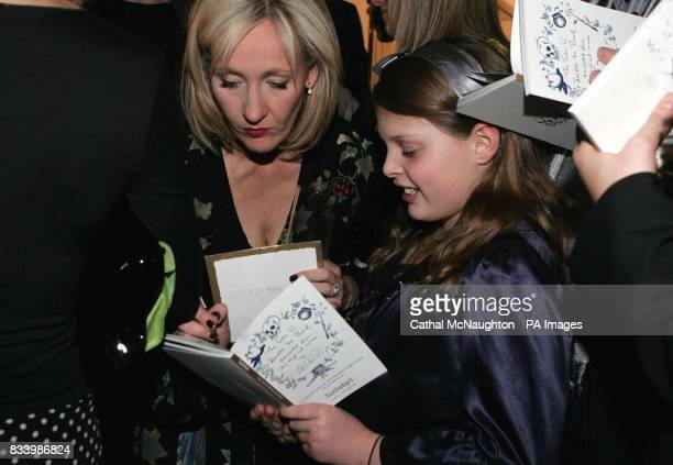 JK Rowling signs autographs before she reads extracts from her book 'The Tales of Beedle the Bard' which is to be auctioned in Sotheby's on Thursday...
