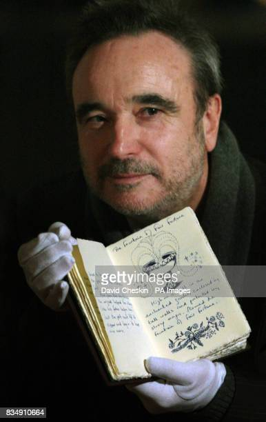JK Rowling's first editor Barry Cunningham holds his copy of 'Tales of Beedle the Bard' The handmade copy of the book is on display and National...