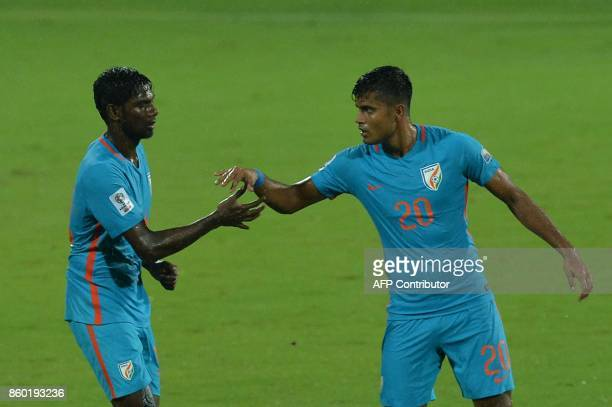 Rowllin of India celebrates with his team mate Pritam Kotal the team's first goal during the 2019 AFCAsian Cup qualifying match between India and...