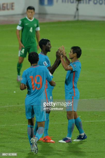 Rowllin of India celebrates with his team mates the team's first goal during the 2019 AFCAsian Cup qualifying match between India and Macau held at...