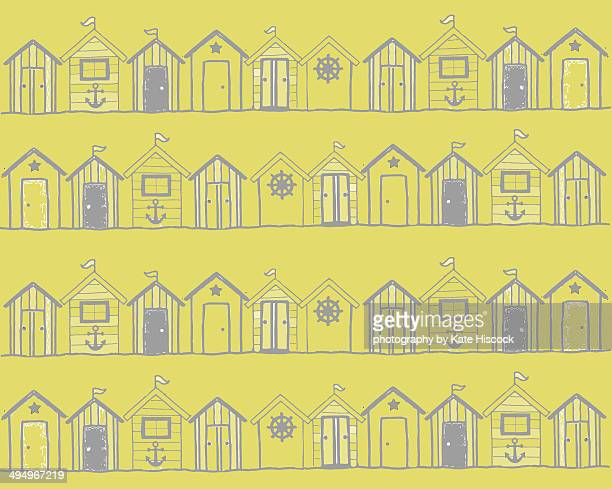 Rows of beach huts on a yellow background