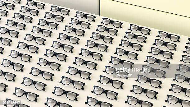 Rows of black glasses on a table