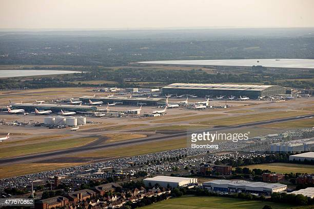 Rows of British Airways aircrafts operated by British Airways Plc sit at Terminal 5 at London Heathrow Airport in this aerial photograph taken over...