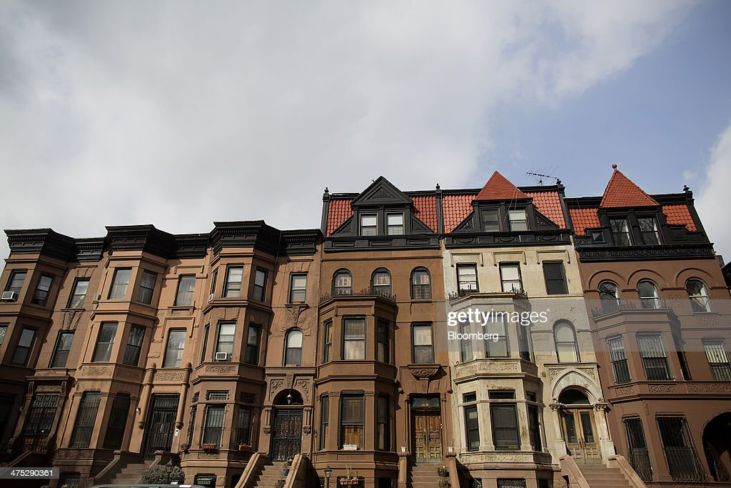 Rows of brownstones stand on a street in the Brooklyn borough of New York, U.S., on Tuesday, Feb. 25, 2014. Home prices in the U.S. climbed at a slower pace in the year through December, pointing to a moderation in the market that will help keep more properties within reach for prospective buyers. Photograph: Victor J. Blue/Bloomberg via Getty Images