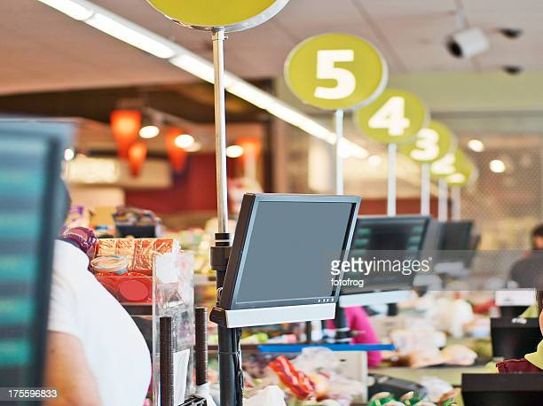 Rows of cashier checkout lanes at a store