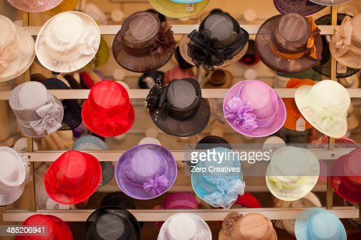 Rows of colorful hats in traditional milliners shop