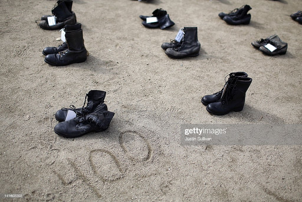 Rows of combat boots that are part of the 'Eyes Wide Open' exhibit are displayed in front of San Francisco City Hall on March 19, 2012 in San Francisco, California. The Eyes Wide Open exhibition includes a pair of boots for every one of the 481 California servicemen and women who died in the Iraq war.