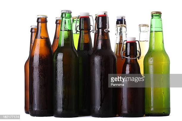 Rows of different color beer bottles