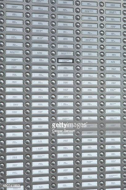 Rows of doorbells on a metal panel