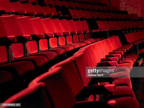 Rows of empty red cinema seats