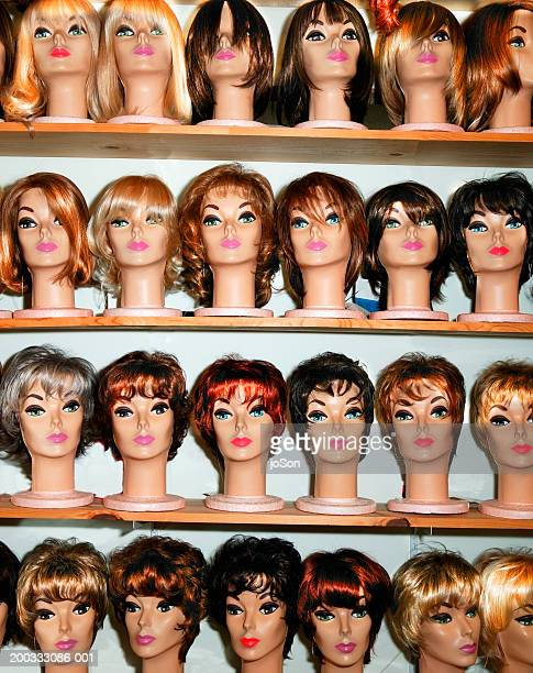 Rows of female mannequin heads on shelves